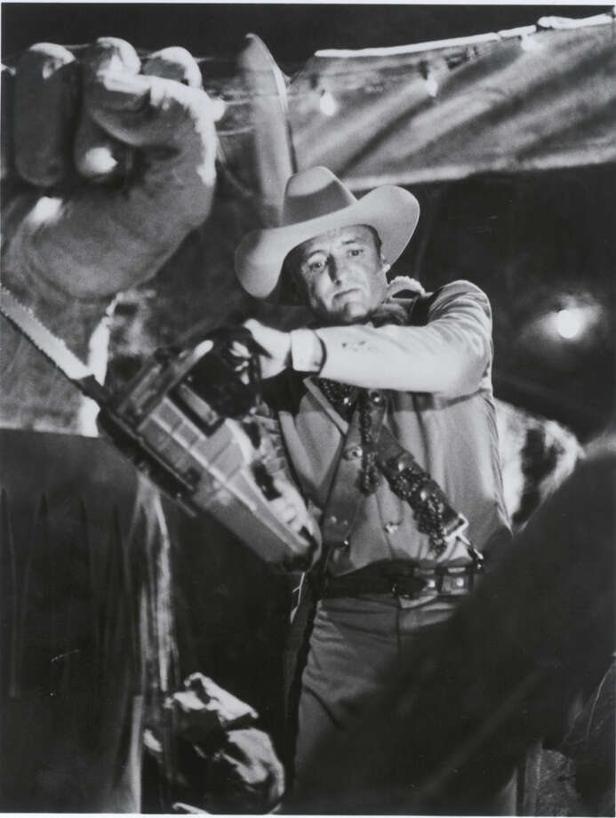 """In """"The Texas Chainsaw Massacre 2"""" (1986), Dennis Hopper  played Lefty Enright, an ex-Texas Ranger, who seeks vengeance for the chainsaw death of his nephew. Photo: Cannon Films / 1986 CANNON FILMS"""