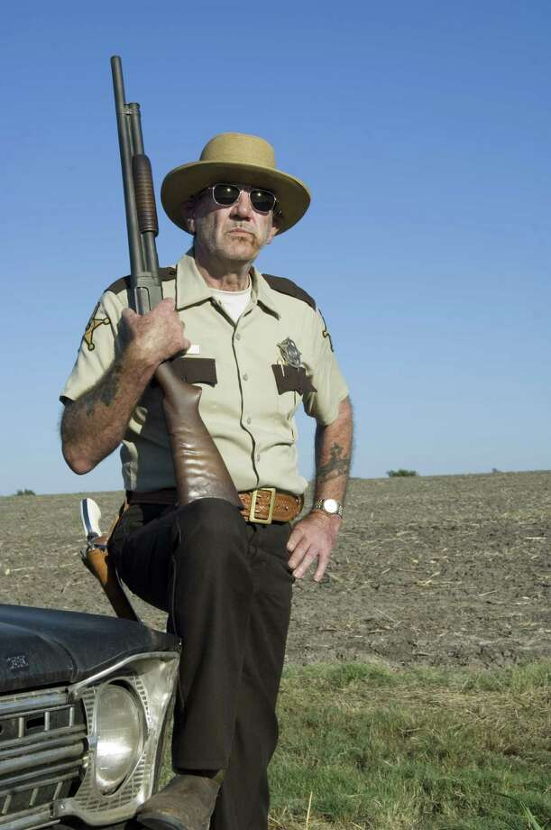"... Sheriff Hoyt in ""The Texas Chainsaw Massacre"" reboot and the 2006 sequel, ""The Texas Chainsaw Massacre: The Beginning"" (pictured). Photo: Van Redin, New Line Cinema / newline.wireimage.com"