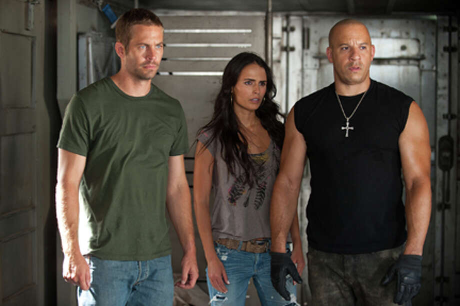 "... she had already played Mia Toretto in ""The Fast and the Furious"" — a role she would reprise in three more ""Fast"" movies (including ""Fast Five,"" pictured) ... and counting. Photo: Jamie Trueblood / 2011 Universal Pictures"