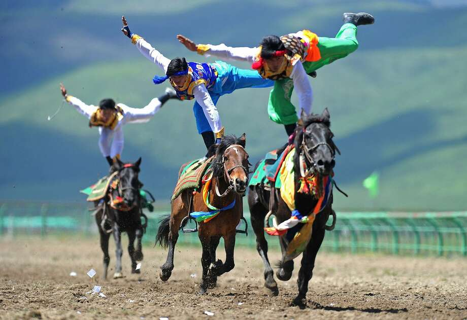 Costumed riders compete in a traditional trick horseback riding event in Aba (also known as Ngawa), Hongyuan county, China. Photo: Afp, Getty Images