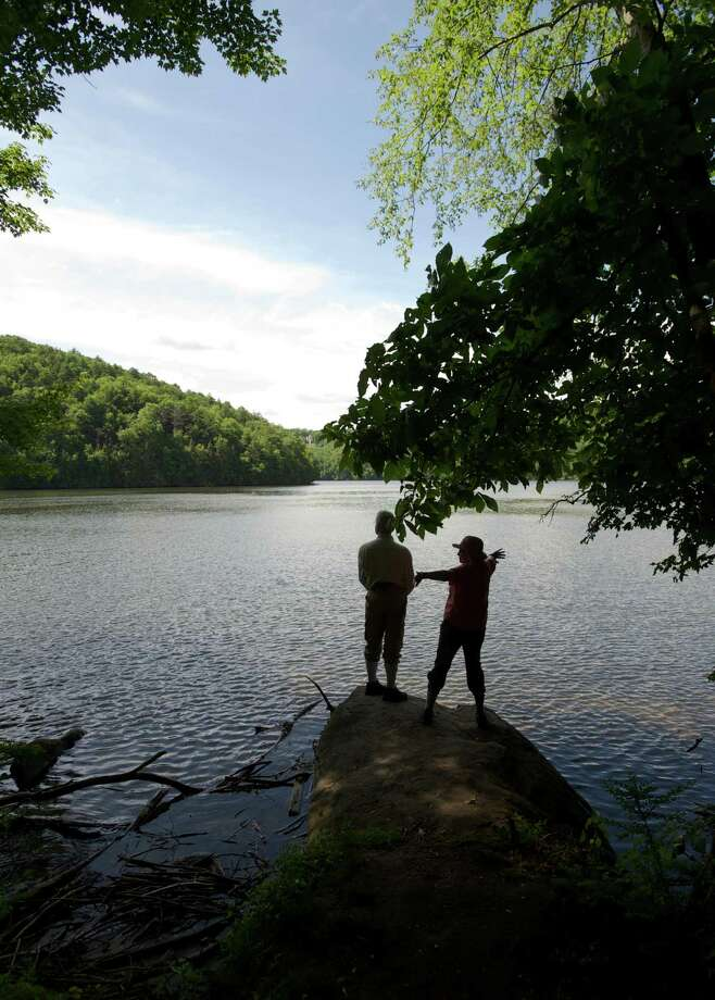 "Cynthia Cornelius, and her husband, Russ Cornelius, of Brookfield, stand on the edge of Lake Lillinonah during the Brookfield Senior Center's ""Hiking Adventures"" hike on Wednesday, June 18, 2014. The hiking program happens twice a month on local trails and features a guest speaker. It is sponsored by the senior center and took place in the Old Bridge Bird Sanctuary, in Brookfield, Conn, with Brookfield First Selectman Bill Tinsley as the guest speaker. Photo: H John Voorhees III / The News-Times Freelance"