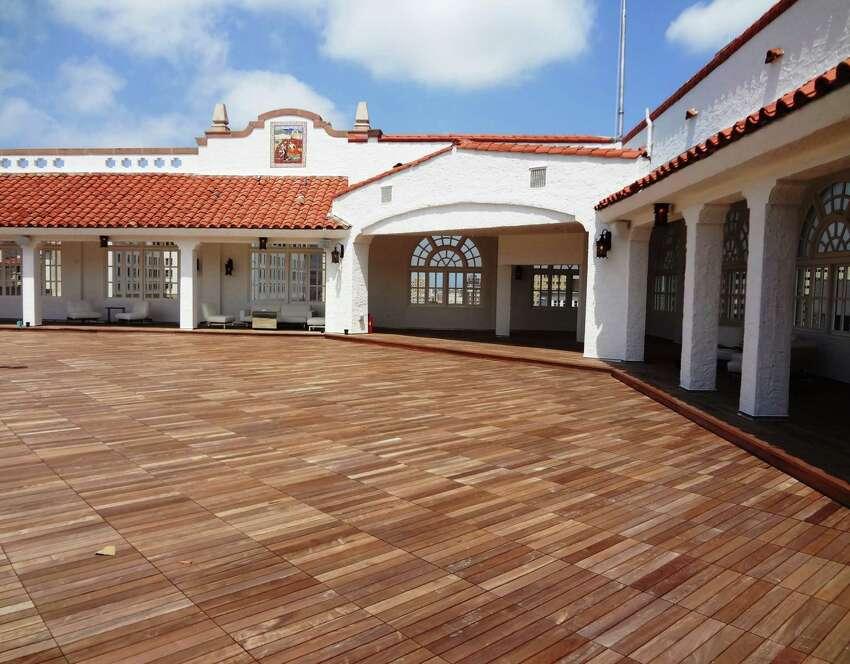 A Mexican-themed rooftop terrace got a new Brazilian hardwood deck.