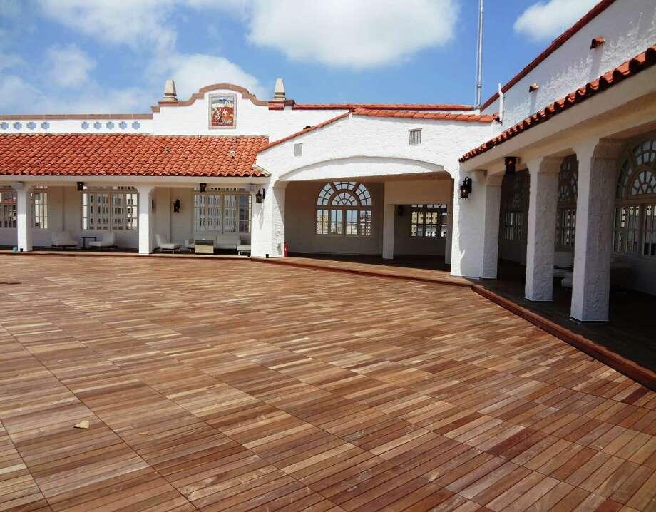 A Mexican-themed rooftop terrace got a new Brazilian hardwood deck. Photo: Photo By Steve Bennett