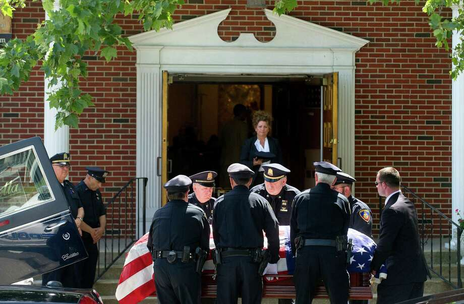 Members of the Stamford Police Department serve as pallbearers for the funeral of former Police Chief Louis DeCarlo at Sacred Heart Roman Catholic Church in Stamford, Conn., on Wednesday, June 18, 2014. Pallbearers were, clockwise from left, Sgt. Anthony Lupinacci, Officer Ed Rondano, Cpt. Gregory Tomlin, Officer Cory Casserta, Sgt. Peter di Spania, and Sgt. Paul Guzda. Photo: Lindsay Perry / Stamford Advocate