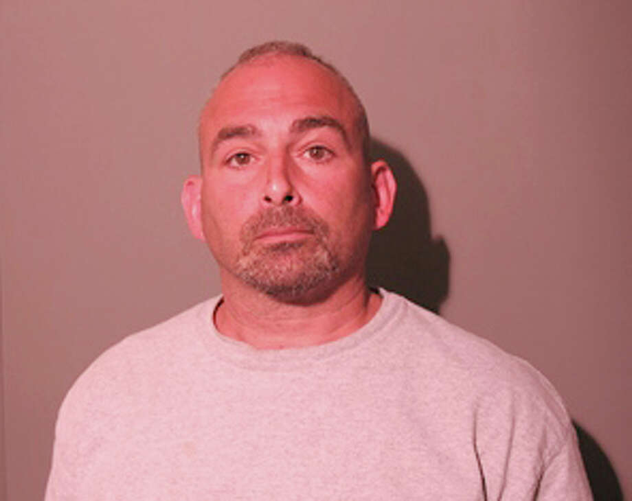 New Canaan Police arrested Mario J. Pizighelli III, 50, of Newtown, Conn., June 10, 2014, on a charge of first-degree larceny for the alleged theft of a $40,000 diamond. Photo: Contributed Photo, Contributed / New Canaan News Contributed