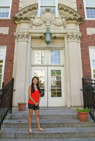Stamford High School senior Lindsay Swatland poses for a photo at the school Wednesday, June 18, 2014. Photo: Lindsay Perry / Stamford Advocate