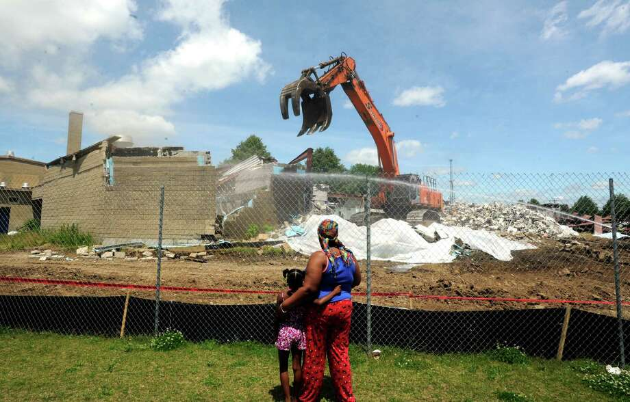 Demolition of the old Longfellow School is underway on Wednesday, June 18, 2014. The old Longfellow School will be replaced by a new building that is scheduled to open in Spring of 2016 at the current site, 139 Ocean Terrace in Bridgeport, Conn. Photo: Cathy Zuraw / Connecticut Post