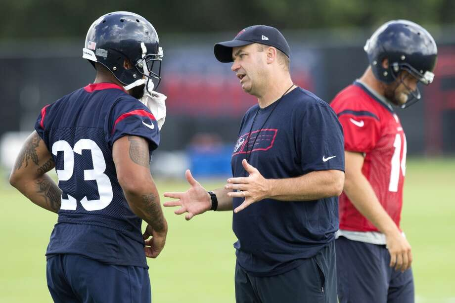 Texans head coach Bill O'Brien talks to running back Arian Foster. Photo: Brett Coomer, Houston Chronicle