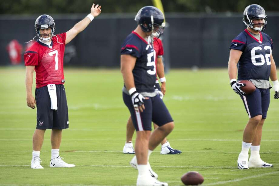 Texans quarterback Case Keenum (7) calls out a play as centers Chris Myers (55) and guard Alex Kupper (62) line up. Photo: Brett Coomer, Houston Chronicle