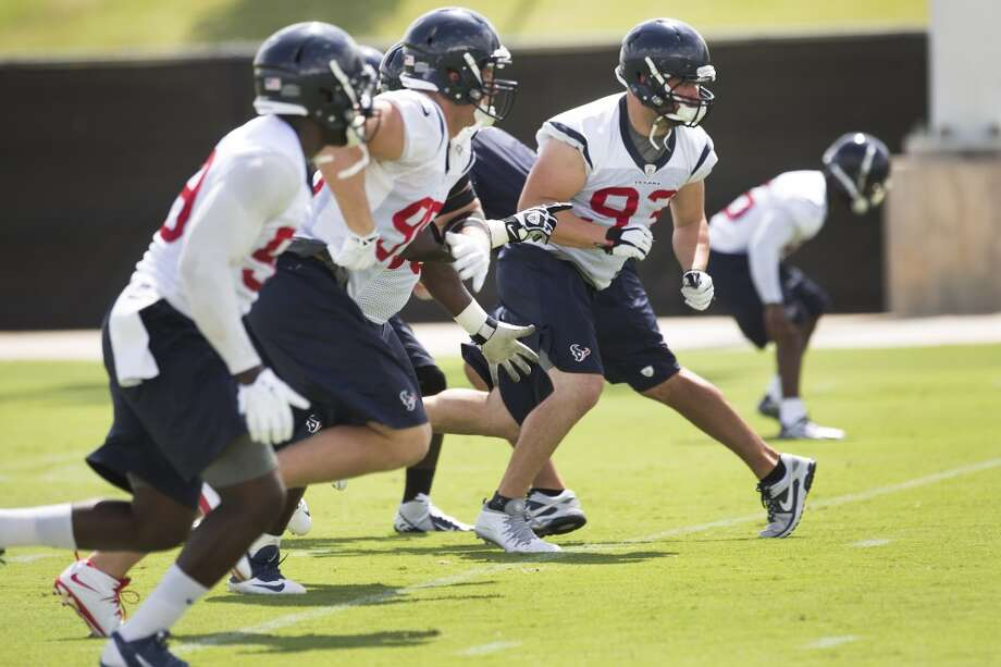 Texans defensive players Whitney Mercilus, far left, J.J. Watt, center, and Jared Crick (93) run a drill. Photo: Brett Coomer, Houston Chronicle