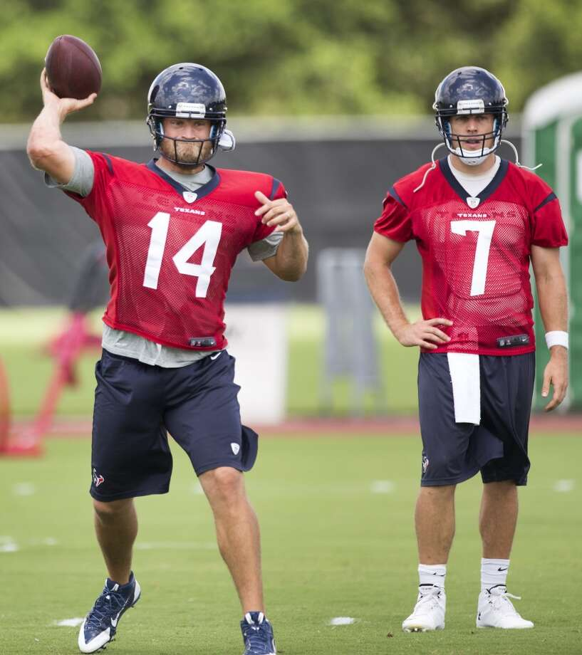 Texans quarterback Ryan Fitzpatrick (14) throws a pass as Case Keenum looks on. Photo: Brett Coomer, Houston Chronicle