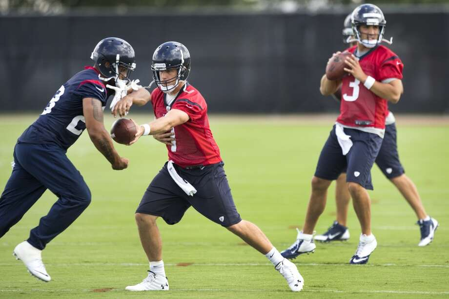Texans running back Arian Foster, far left, takes a handoff from quarterback Case Keenum (7), with Tom Savage (3) shown in the background. Photo: Brett Coomer, Houston Chronicle