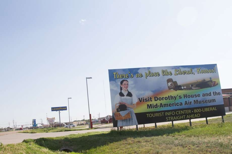 A billboard welcomes visitors to see the Dorothy house on the outskirts of Liberal, KS. Photo: Douglas Zimmerman, Courtesy