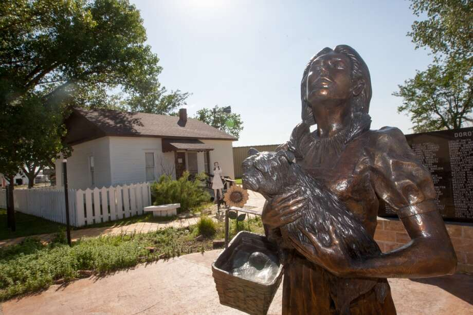 "A statue of Dorthy stands outside ""Dorthy's House,"" a replica of the house that appeared in the movie ""The Wizard of Oz"" Vargas in Liberal, KS. Photo: Douglas Zimmerman, Courtesy"