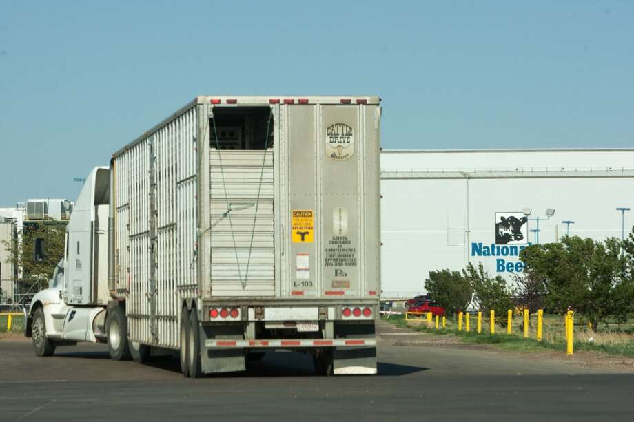 A tractor trailer pulls inside  the National Beef Meat Packing building in Liberal, KS. Photo: Douglas Zimmerman, Courtesy