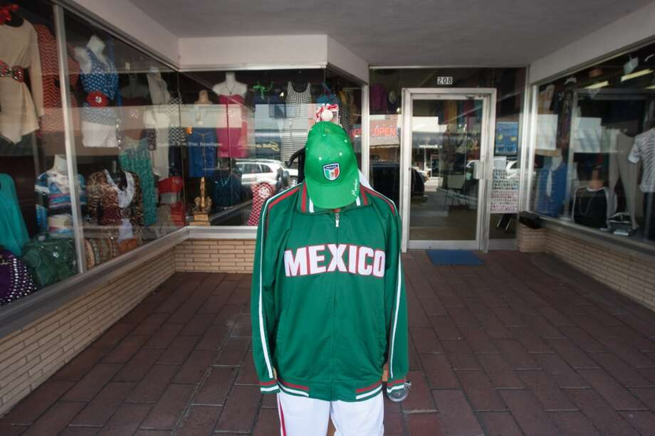 A mannequin is adorned with  Mexico soccer gear outside a clothing store in downtown Liberal, KS. Photo: Douglas Zimmerman, Courtesy