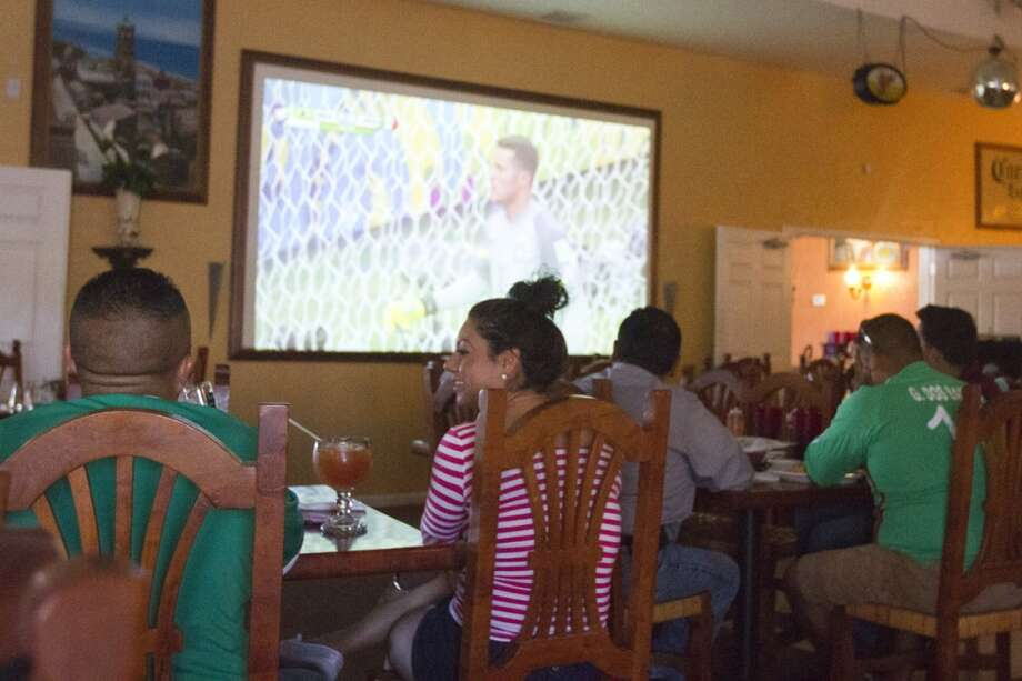 Mexico soccer fans watch the Mexico vs. Brazil first round World Cup match at Vargas restaurant in Liberal, KS. Photo: Douglas Zimmerman, Courtesy