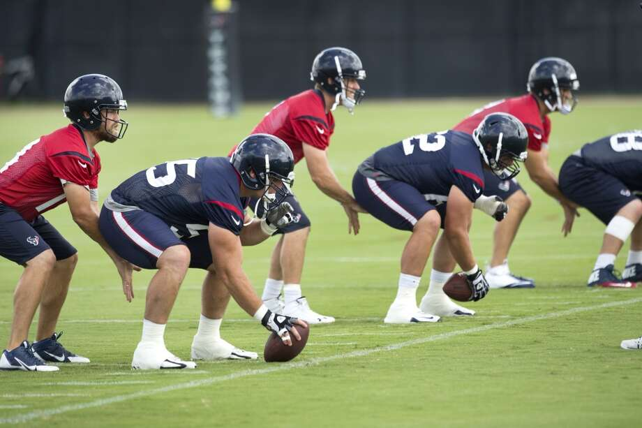 June 18  Texans quarterback Ryan Fitzpatrick, far left, lines up under center Chris Myers. Photo: Brett Coomer, Houston Chronicle