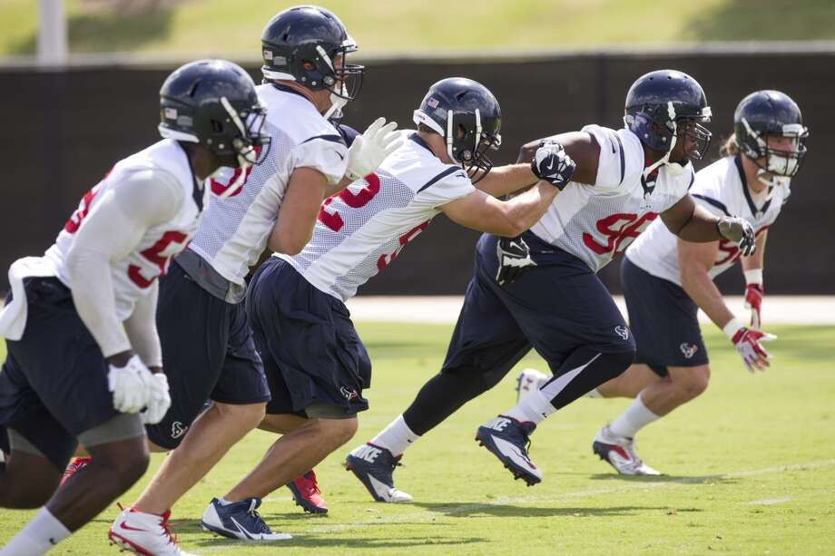 Texans defensive players, from left, Whitney Mercilus, J.J. Watt, Jeff Tarpinian, Tim Jamison (96) and Brooks Reed, far right, run a drill. Photo: Brett Coomer, Houston Chronicle