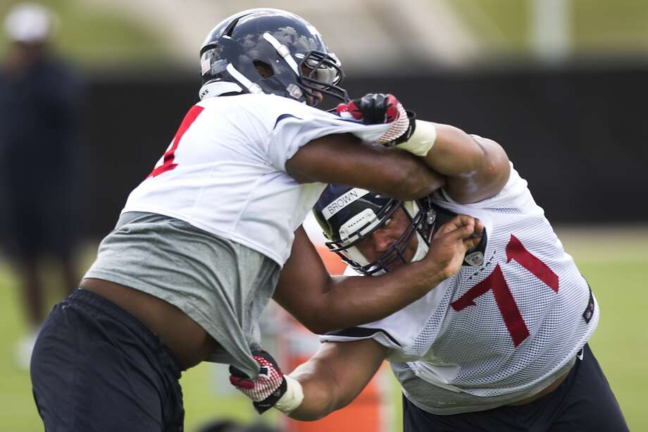 Texans nose tackle Austin Brown (71) works against defensive end Julius Warmsley. Photo: Brett Coomer, Houston Chronicle