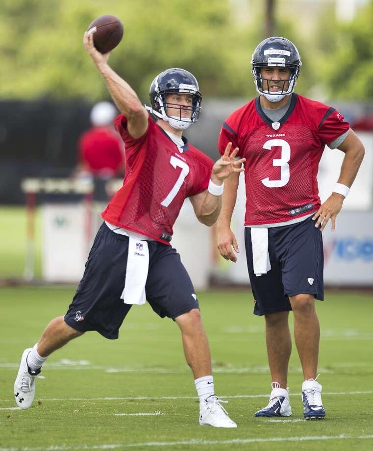 Texans quarterback Case Keenum (7) throws a pass as Tom Savage (3) looks on. Photo: Brett Coomer, Houston Chronicle