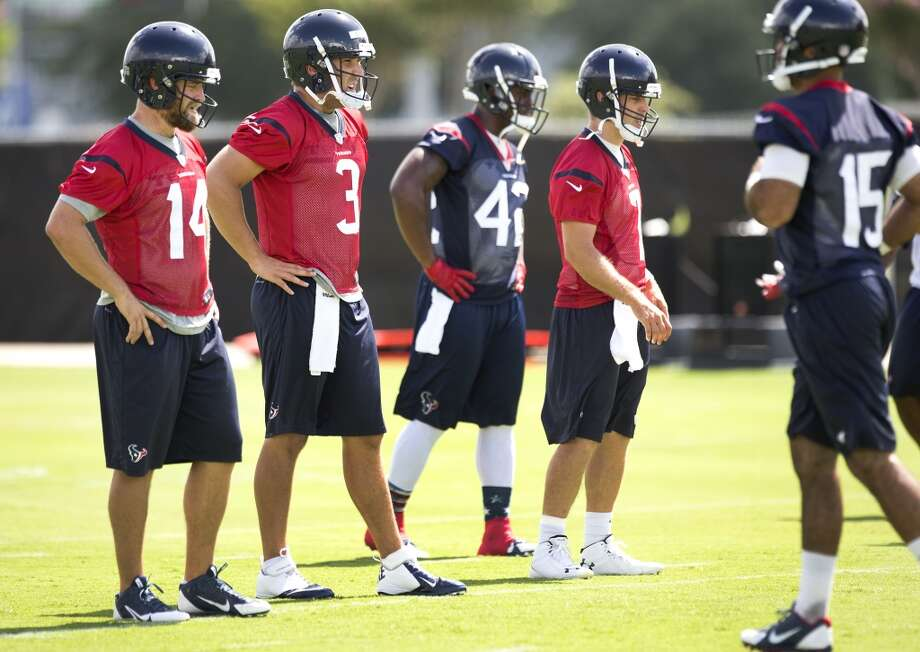 Texans quarterbacks Ryan Fitzpatrick (14), Tom Savage (3) and Case Keenum (7) line up to run drills. Photo: Brett Coomer, Houston Chronicle