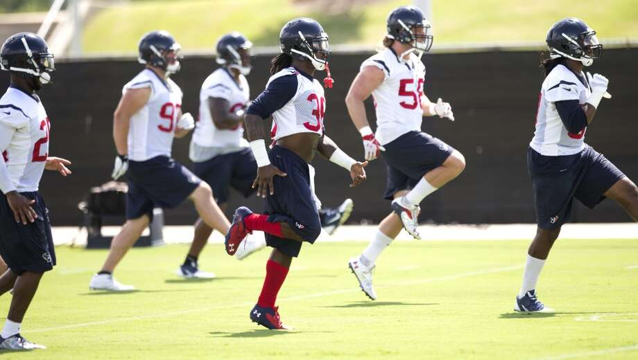 Texans defensive players warm up. Photo: Brett Coomer, Houston Chronicle