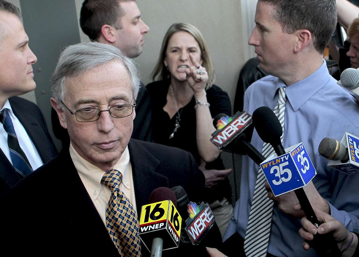 """A former presiding judge in Pennsylvania, known for his hardline sentencing of juveniles, is confronted by an enraged mother outside his own corruption trial in Robert May's documentary, """"Kids for Cash."""" Sandy Fonzo of Wilkes-Barre screams at former Judge Mark Ciavarella saying that he was responsible for her son's suicide on the steps of the federal courthouse in Scranton Friday afternoon. BILL TARUTIS/FOR THE TIMES LEADER"""