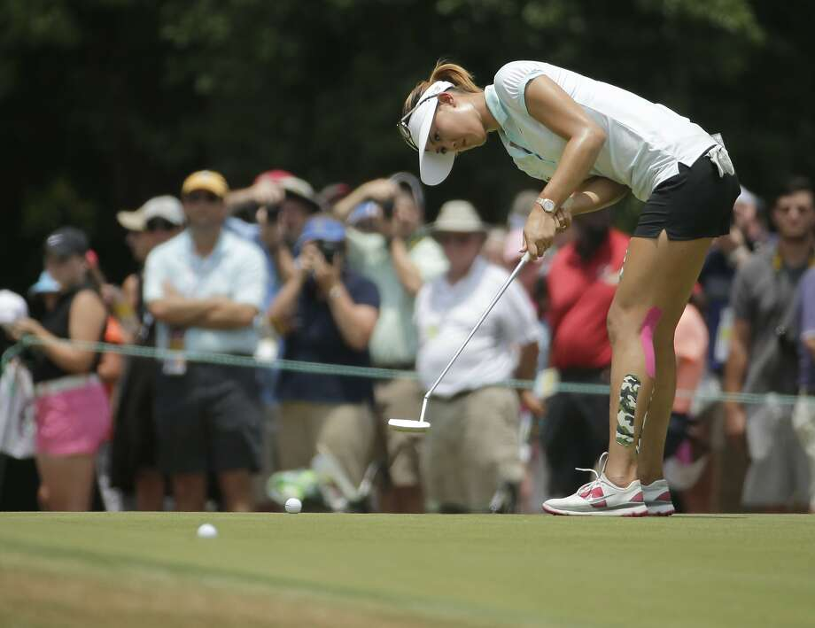 Stanford alum Michelle Wie, whose best U.S. Open finish is a tie for third in 2006, putts on Pinehurst's second green. Photo: Chuck Burton, Associated Press