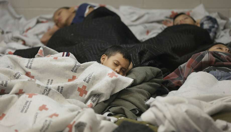 Young detainees sleep in a holding cell at the Fort Brown Border Patrol station in Brownsville, Texas. Photo: Eric Gay, Associated Press