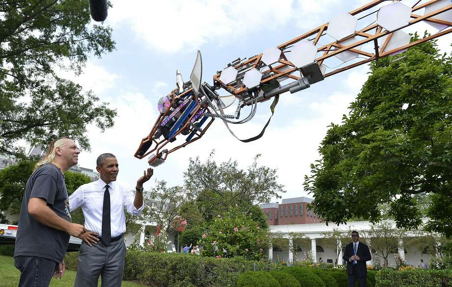 Lindsay Lawlor (left) of San Diego discusses his robotic giraffe with President Obama at the White House Maker Faire, which featured more than 100 participants from 25 states. Photo: Pool, Getty Images