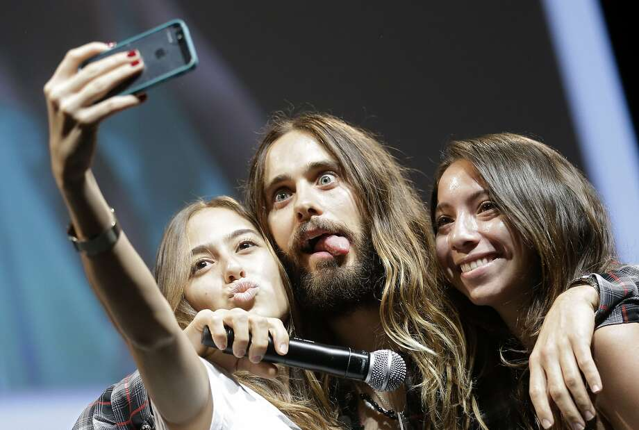 Hello, Handsome!Jared Leto mugs for the camera while posing for a fan selfie at the Cannes Lions International Advertising Festival in Cannes, France. Photo: Lionel Cironneau, Associated Press
