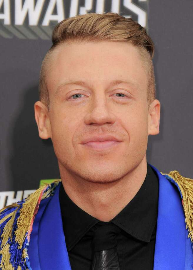 Macklemore arrives at the MTV Movie Awards in Sony Pictures Studio Lot in Culver City, Calif., on Sunday April 14, 2013. (Photo by Jordan Strauss/Invision/AP) Photo: Jordan Strauss / Invision