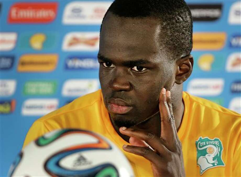(8) Cheick Tiote of Ivory Coast. Pronounced 'Sheck Tea-o-tey, which announcers find any excuse to shout out. Started playing soccer in his barefeet at age 10 and didn't own a pair of boots until 15. He's the proud owner of a great name, though. (AP Photo/Sergei Grits)