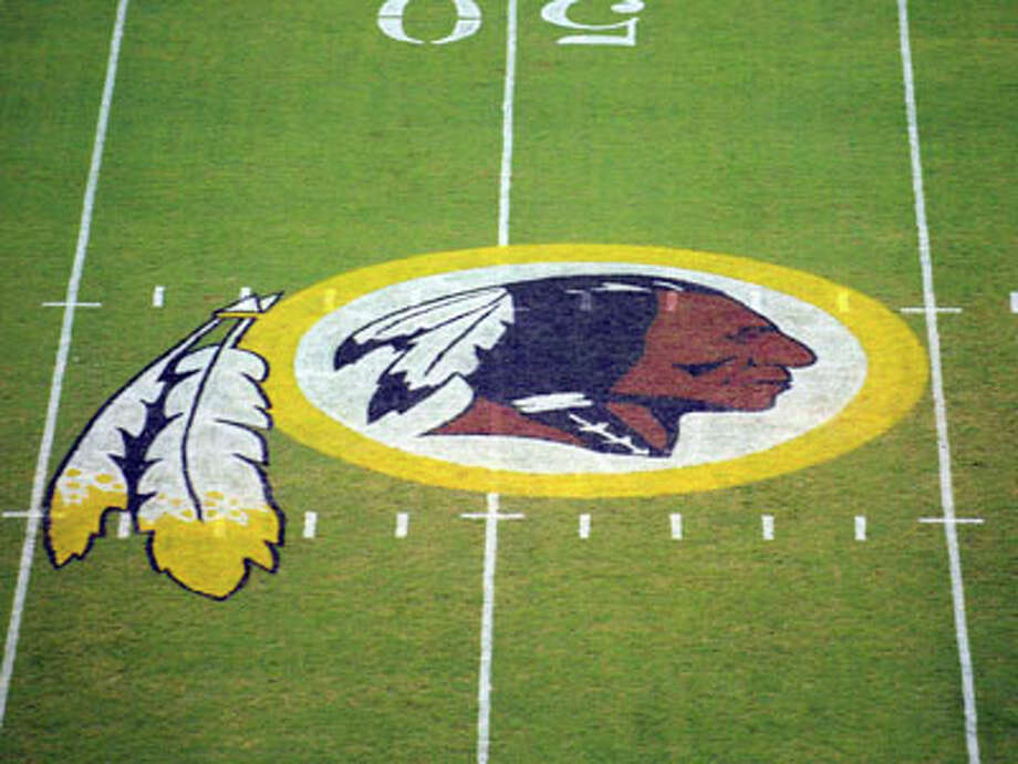"FILE - In this Aug. 28, 2009, file photo, the Washington Redskins logo is displayed at midfield before the start of a preseason NFL football game in Landover, Md. The team's nickname, which some consider a derogatory term for Native Americans, has faced a barrage of criticism. But a new Associated Press-GfK poll shows that nationally, ""Redskins"" still enjoys widespread support. Photo: Nick Wass, AP / AP2009"
