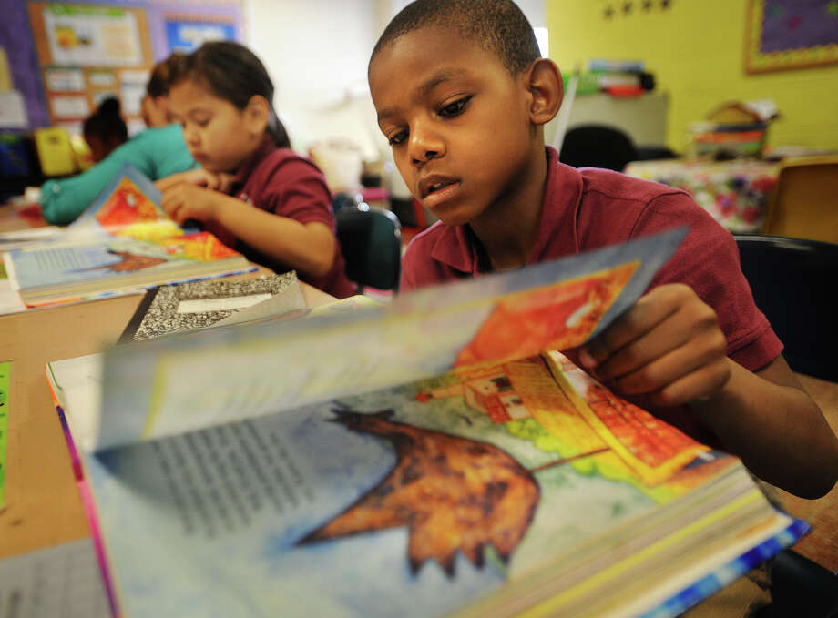 Student Jason Marshall reads along attentively in Virginia Hudson-Johnson's second grade class at Dunbar School in Bridgeport, Conn. on Tuesday, June 3, 2014. Photo: Brian A. Pounds / Connecticut Post