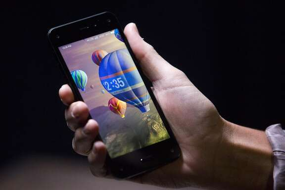 The Amazon.com Inc. Fire Phone is displayed for a photograph during an event at Fremont Studios in Seattle, Washington, U.S., on Wednesday, June 18, 2018. Amazon.com Inc. jumped into the crowded smartphone market with its own handset called Fire Phone, ramping up competition with Apple Inc. and Samsung Electronics Co. Photographer: Mike Kane/Bloomberg