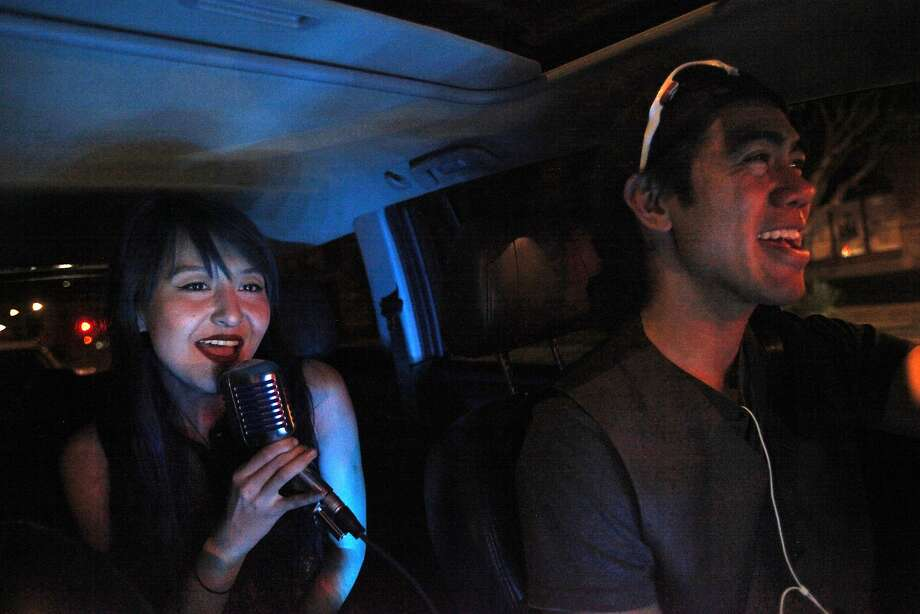 "Sophie Xie sings ""Stay"" by Rihanna while riding with Lyft driver June Cuaresma, who joins in the song with his passenger. Photo: Leah Millis, The Chronicle"
