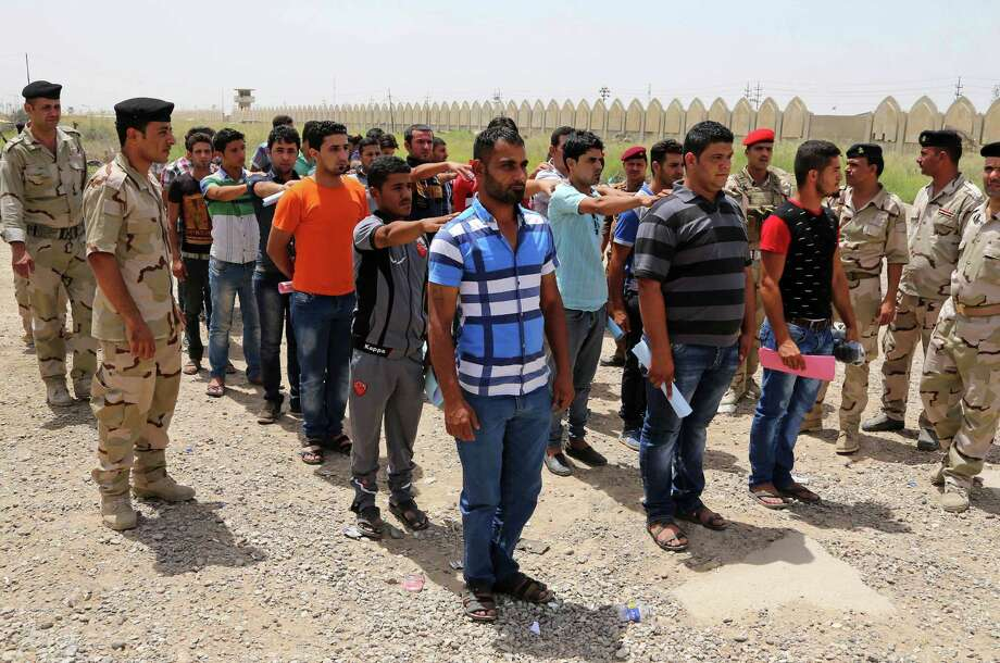 Iraqi men line up to volunteer for military service in Baghdad to help battle insurgents. U.S. intervention in the conflict in Iraq and Syria would only make things worse for the people of the region and for our national interests. Photo: Karim Kadim / Associated Press / AP