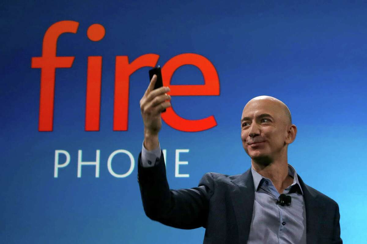 Amazon CEO Jeff Bezos introduces the new Amazon Fire Phone, Wednesday, June 18, 2014, in Seattle. (AP Photo/Ted S. Warren) ORG XMIT: WATW103