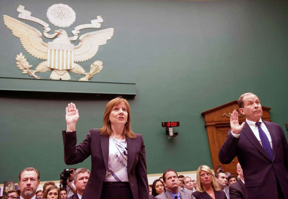 General Motors CEO Mary Barra, CEO, left, and former US Attorney Anton Valukas, investigator, Jenner & Block, are sworn-in on Capitol Hill in Washington, Wednesday, June 18, 2014, prior to testifying before the House Energy and Commerce Committee's Oversight and Investigations subcommittee hearing on examining the facts and circumstances that contributed to General Motors' failure to identify a safety defect in certain ignition switches and initiate a recall in a timely manner. (AP Photo/Cliff Owen) ORG XMIT: DCCO101 Photo: Cliff Owen / FR170079 AP