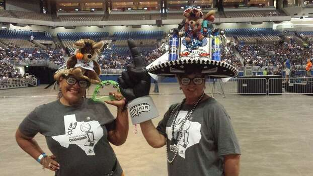 Sisters Dora Gonzales and Pauline Grossman show off the extravagant, homemade hats they wore throughout the Finals while they wait for the Spurs celebration to start at the Alamodome on Wednesday, June 18, 2014. Photo: Mark Dore/San Antonio Express-News