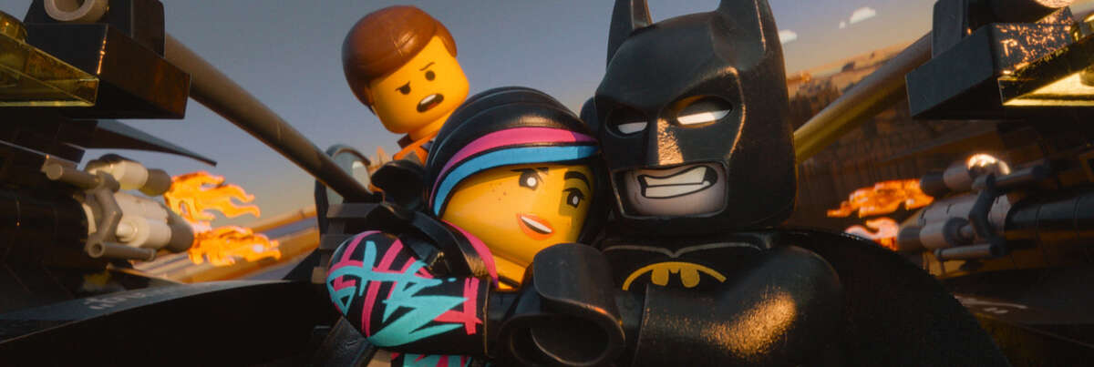 """This image released by Warner Bros. Pictures shows characters, from left, Emmet, voiced by Chris Pratt, Wyldstyle, voiced by Elizabeth Banks and Batman, voiced by Will Arnett, in a scene from """"The Lego Movie."""" (AP Photo/Warner Bros. Pictures)"""