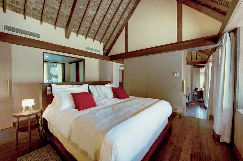 The 30 one-bedroom villas, 1,033 square feet each, come with a walk-through dressing area to the bedroom with king bed.  Bedrooms offer a view of the lagoon filtered by pandanus, miki and coconut trees. Photo: Tim McKenna, © Tim-mckenna.com / ©tim-mckenna.com