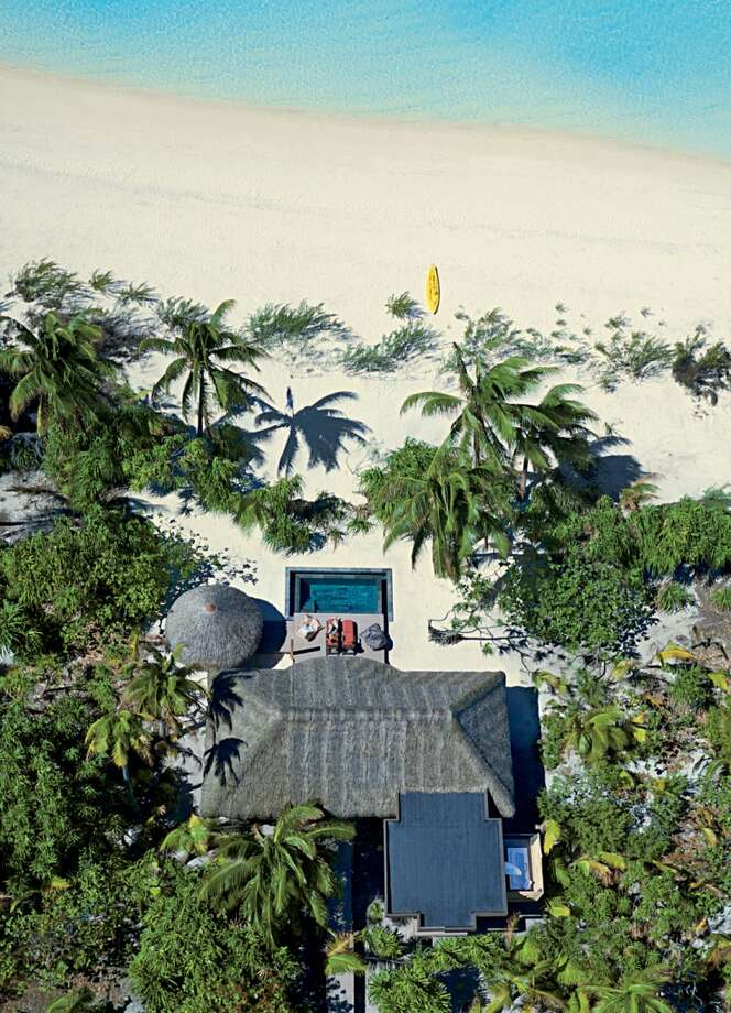Panels for solar power are one way villas at the Brando (seen from above) are part of the resort's efforts toward sustainability, a dream of the atoll's former owner, Marlon Brando. Photo: © Tim Mckenna-tahitiflyshoot