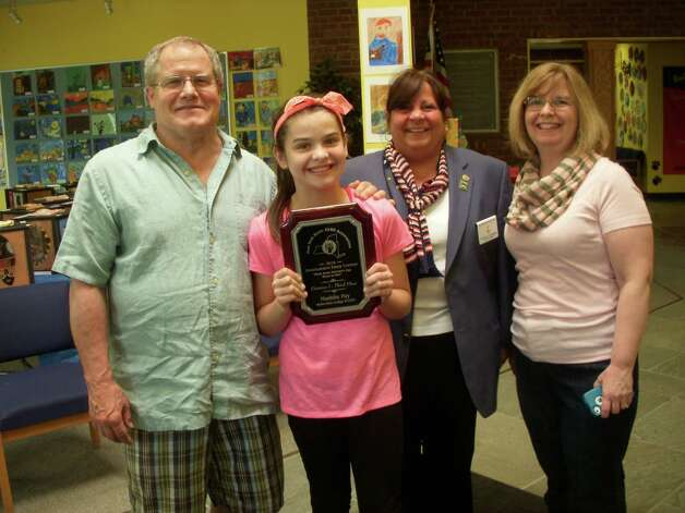 Menands sixth-grader Maddie Fay won third place in her division for her Americanism essay in the state contest sponsored by the New York State Elks. Davis Fay, Maddie Fay, Elks Exalted Ruler Patti Gardner and Laurie Fay.