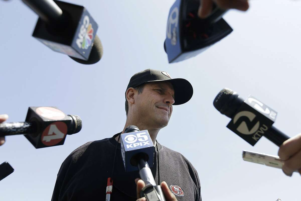 San Francisco 49ers coach Jim Harbaugh speaks to reporters during an NFL football rookie camp in Santa Clara, Calif., Friday, May 23, 2014. (AP Photo/Jeff Chiu)