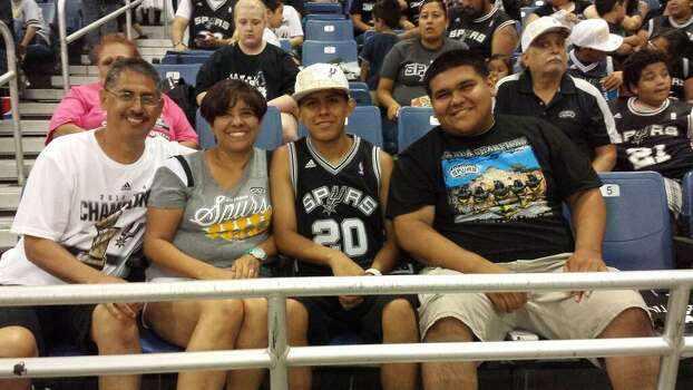 The Trevino family waits for the start of the Spurs celebration at the Alamodome on Wednesday, June 18, 2014. They often vacation in San Antonio. As in 1999, they're here for the Finals — by design. Photo: Mark Dore/San Antonio Express-News