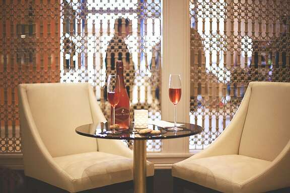 Looking Glass, which opened in March, is a contemporary fashion boutique-meets-Champagne tasting room, where shoppers can enjoy a $9 Champagne flight or $30 to $100 bottle of sparkling wine.