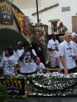"Spurs legend George ""Iceman"" Gervin takes pictures of the crowd from the first barge in the Spurs river parade on Wednesday, June 18, 2014. Photo: Mitchell Ferman / San Antonio Express-News"